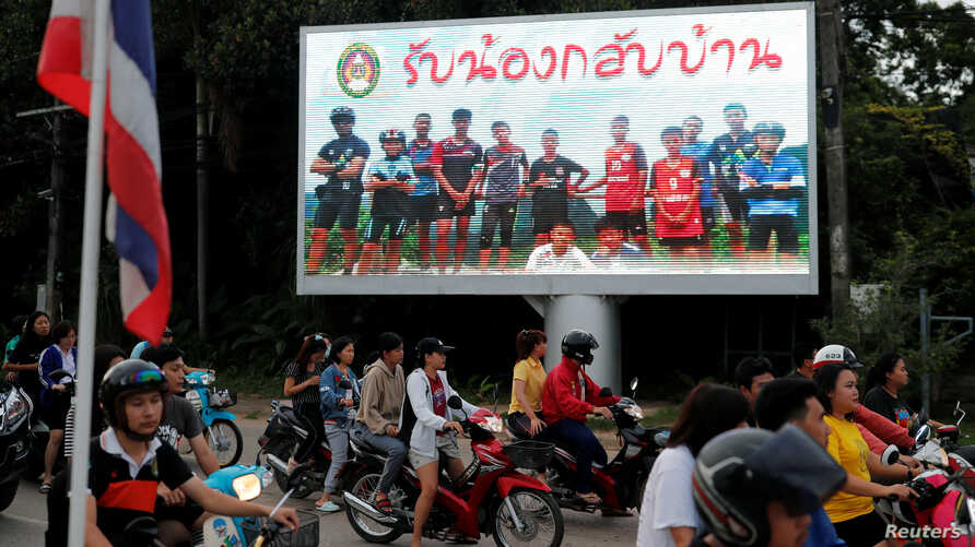"A board showing ""Welcome home, boys"", is seen after rescue effort has begun for the 12 schoolboys and their soccer coach trapped in Tham Luang cave, in Chiang Rai, Thailand, July 9, 2018."