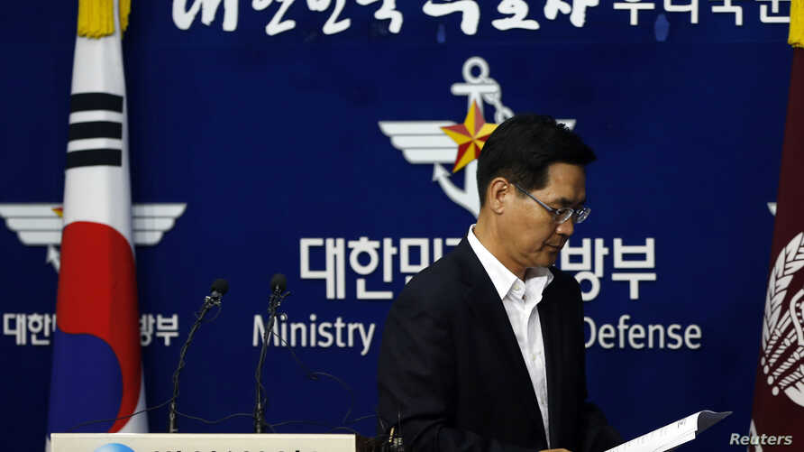 FILE - South Korea's Defense Ministry spokesman Kim Min-seok leaves after a briefing at the Defense Ministry in Seoul.