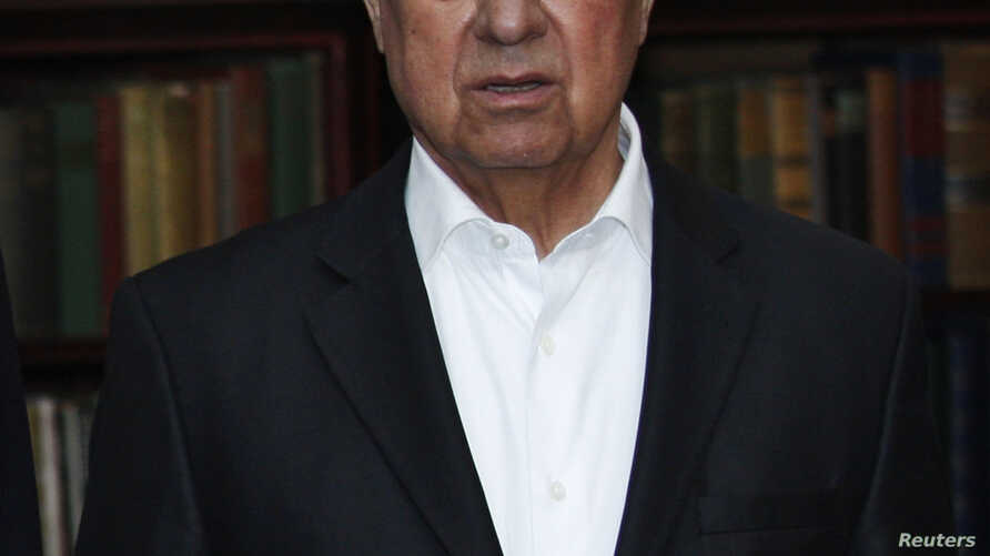 FILE - Turkish Cypriot leader Dervis Eroglu attends a photo call during a meeting with the leaders of the Greek and Turkish Cyprus communities at the Greentree estate in Manhasset, New York.