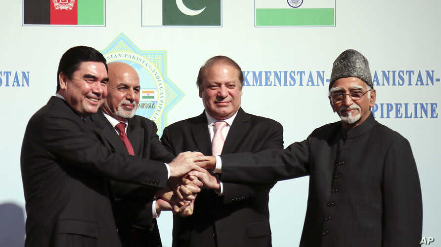 FILE - Turkmen President Gurbanguly Berdymukhamedov (L) shakes hands with Afghan President Ashraf Ghani (2nd-L), Pakistani Prime Minister Mohammad Nawaz Sharif (2nd-R), and Indian Vice President Hamid Ansari during a ceremony in Ashgabat, Turkmenista