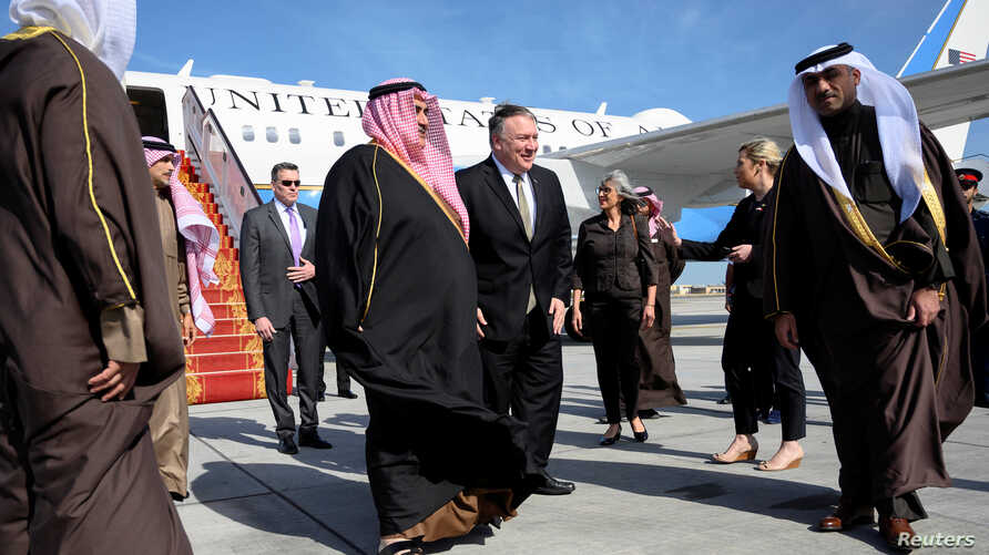 U.S. Secretary of State Mike Pompeo is welcomed by Bahraini Foreign Minister Khalid bin Ahmed Al Khalifa after arriving at Manama International Airport in Manama, Bahrain, Jan. 11, 2019.