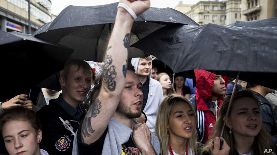 People shout during an opposition rally demanding free internet in Moscow, Russia, Aug. 26, 2017. Several hundreds people hold a protest against government's internet policy in downtown Moscow.