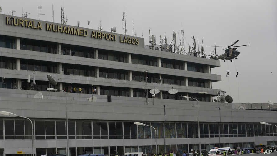 FILE - Nigerian Air Force special unit practices a counter-terrorism exercise at the Murtala Muhammed International Airport in Lagos, Nigeria.