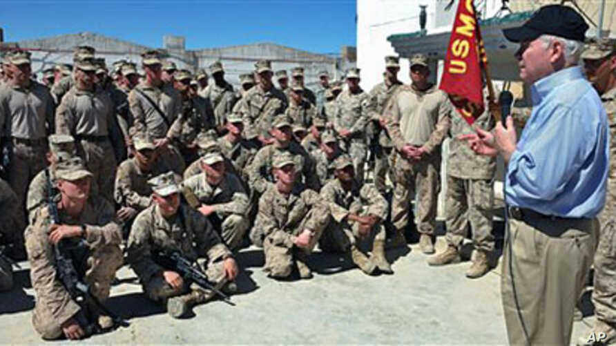 US Defense Secretary Robert Gates speaks to Marines while visiting the 3rd Battalion, 5th Marine Regiment at Forward Operating Base Sabit Qadam in Helmand province, Afghanistan, March 8, 2011 (file photo)