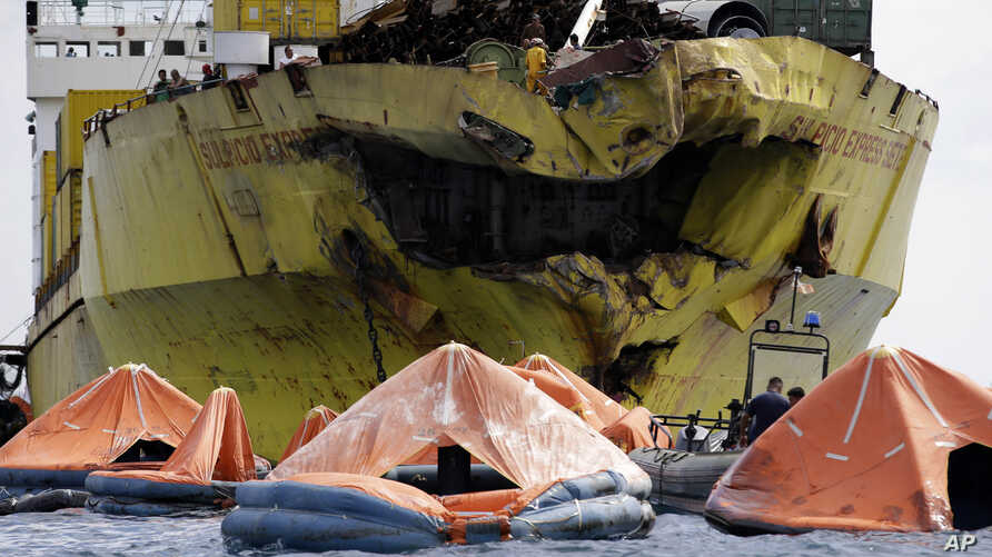 A cluster of life rafts floats near the cargo ship Sulpicio Express Siete, Aug. 17, 2013, a day after it collided with a passenger ferry off the waters of Talisay city, Cebu province in central Philippines. Divers combed through a sunken ferry Saturd