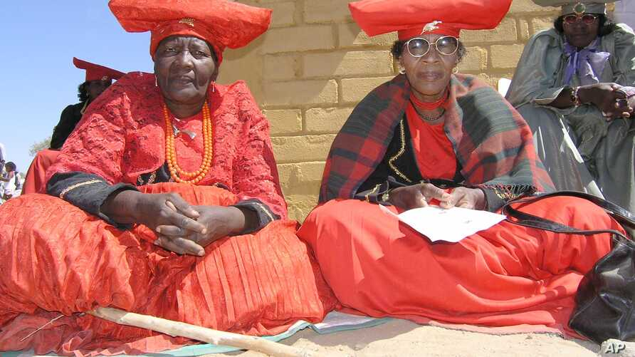 Herero women attend a gathering in Okokarara, Namibia, Aug. 14, 2004 where Germany's Development Aid Minister, Heidemarie Wieczorek-Zeul, unseen, offered Germany's first apology for a colonial-era crackdown that killed 65,000 ethnic Hereros between 1