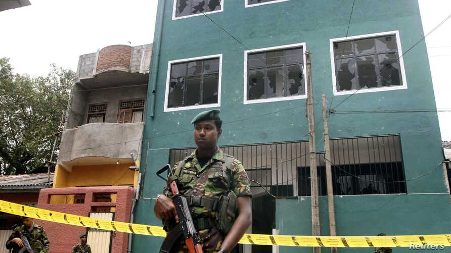 Special Task Force Commandos stand guard outside a vandalized mosque in Colombo, Sri Lanka,  Aug. 11, 2013.