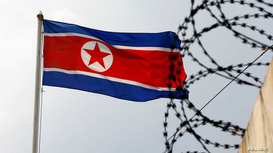 The North Korea flag flutters next to concertina wire at the North Korean embassy in Kuala Lumpur, Malaysia