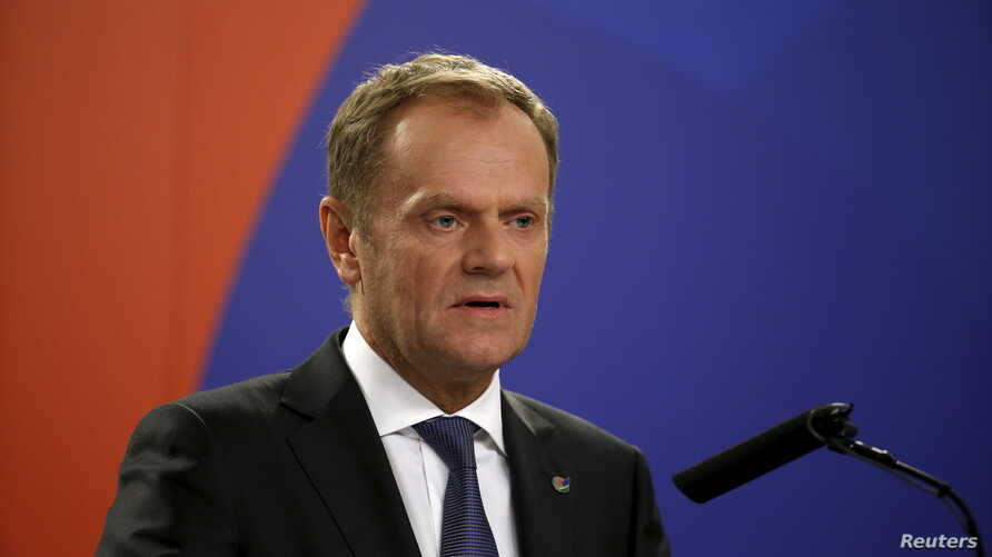 European Council President Donald Tusk addresses a joint press conference with Maltese Prime Minister Joseph Muscat and President Macky Sall of Senegal at the end of the Valletta Summit on Migration in Valletta, Malta, Nov. 12, 2015.