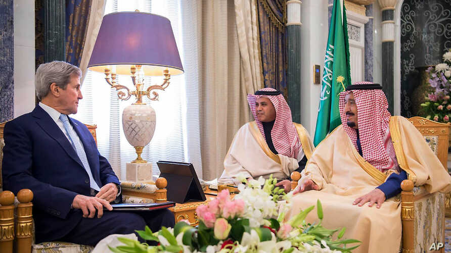 In this handout image provided by the state owned Saudi Press Agency, U.S. Secretary of State John Kerry, left, meets with Saudi King Salman right, in what likely will be his last visit as America's top diplomat, Dec. 18, 2016