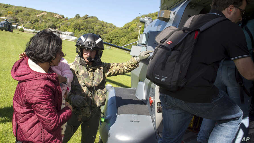 In this image provided by the Royal New Zealand Defense Force, tourists are evacuated by helicopter from Kaikoura following Monday's earthquake, in New Zealand, Nov. 15, 2016.