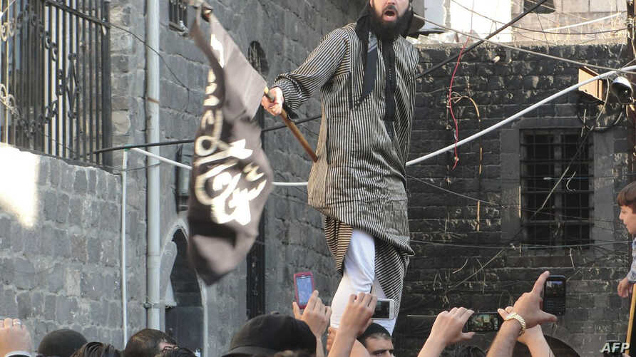 A handout image released by the Syrian opposition's Shaam News Network allegedly shows a Syrian opposition activist waving an black flag of the Islamist Jihadists during a demonstration against the Syrian regime after the Eid al-Fitr prayer in the th