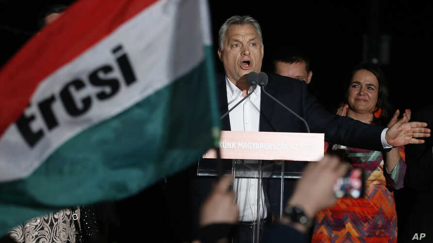 Hungary ElectionsHungarian Prime Minister Viktor Orban addresses his supporters in Budapest, Hungary, April 8, 2018, after preliminary results show him easily winning a third consecutive term after Sunday's parliamentary election.