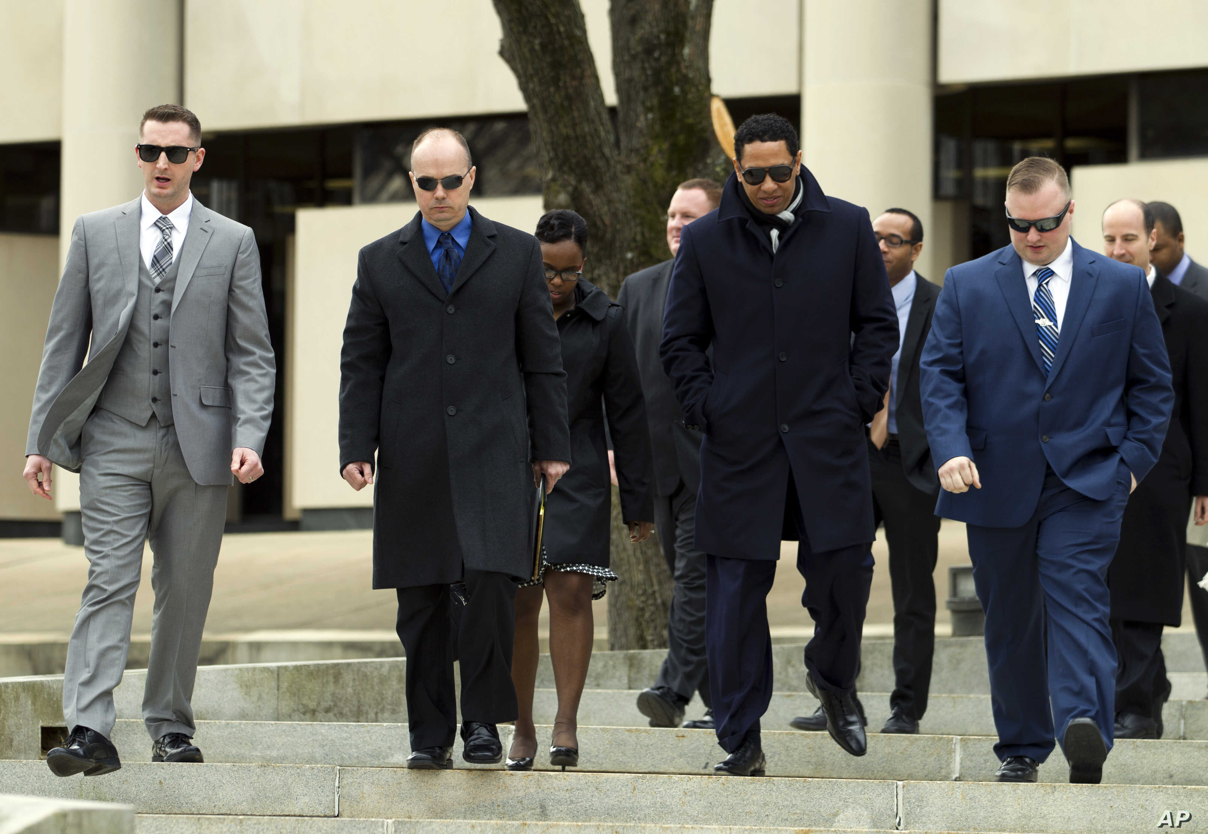 FILE - Officer Edward Nero, left, Lt. Brian Rice, second from left, and Officer Garrett Miller, at right, three of six Baltimore city police officers charged in connection to the death of Freddie Gray, leave the Maryland Court of Appeals, March 3, 20