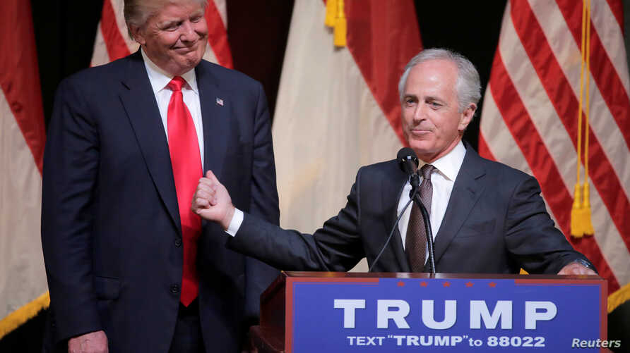 Republican U.S. presidential candidate Donald Trump listens as Senator Bob Corker speaks at a campaign rally in Raleigh, North Carolina, July 5, 2016. On Wednesday, Corker withdrew his name from consideration as Trump's possible pick for vice preside