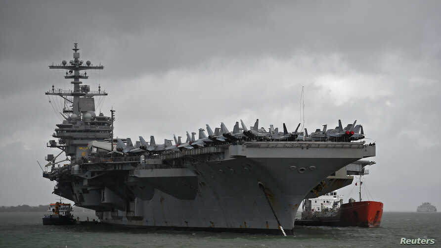 The USS George H.W. Bush aircraft carrier is seen anchored off Stokes Bay in the Solent, Britain, July 27, 2017.