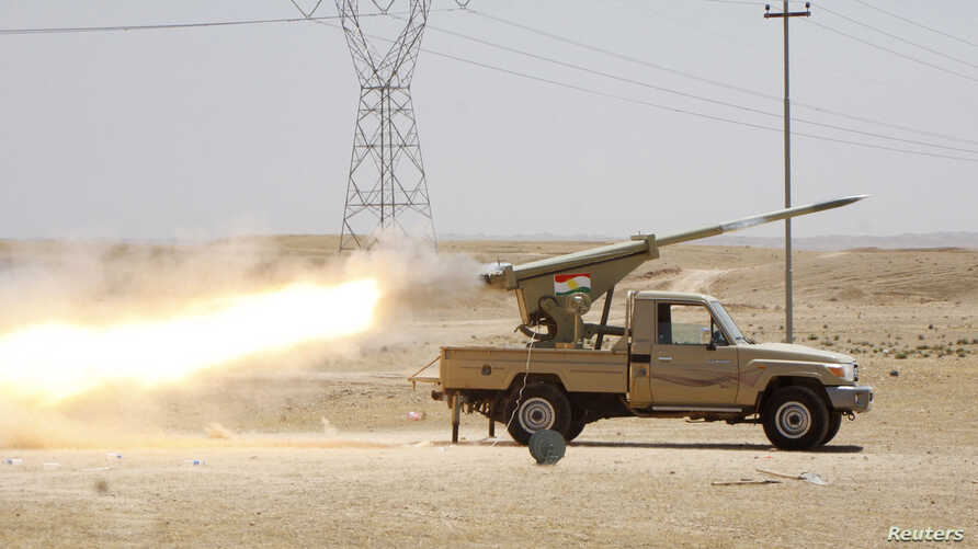 Kurdish security forces fire a multiple rocket launcher during clashes with the Islamic State of Iraq and the Levant in Jalawla, Diyala province, Iraq, June 29, 2014.