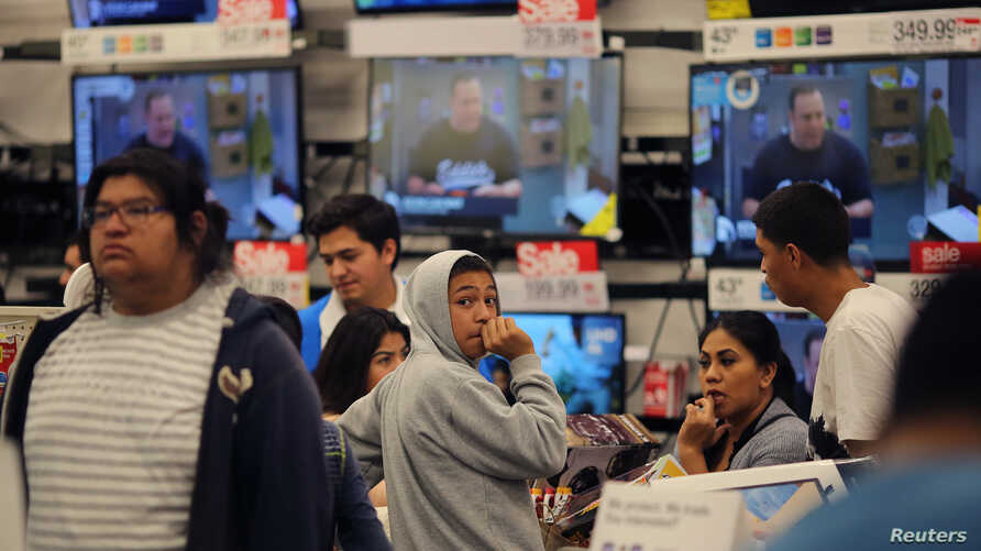 Shoppers stand in a checkout line during Black Friday sales at a Target store in Culver City, California, Nov. 25, 2016.