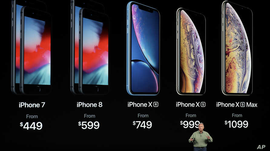 Phil Schiller, Apple's senior vice president of worldwide marketing, speaks about the new Apple iPhone XS, iPhone XS Max and the iPhone XR at the Steve Jobs Theater during an event to announce new Apple products, Sept. 12, 2018, in Cupertino, Calif.