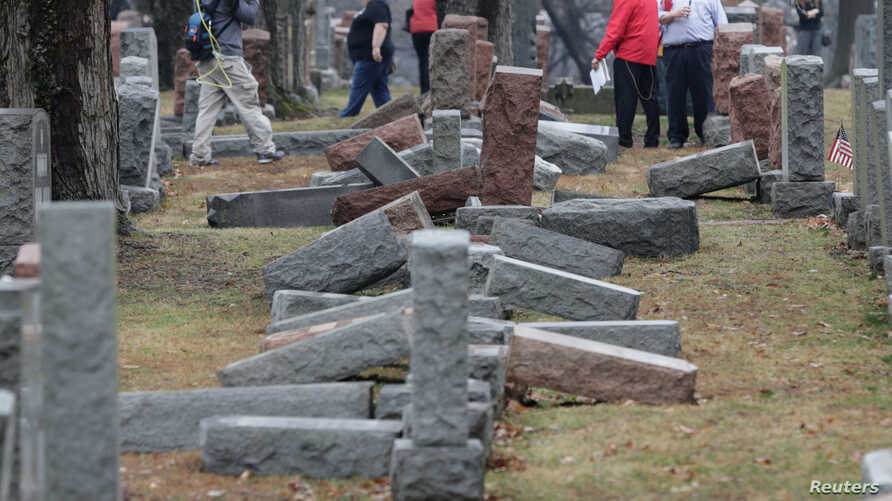 Local and national media report on more than 170 toppled Jewish headstones after a weekend vandalism attack on Chesed Shel Emeth Cemetery in University City, a suburb of St Louis, Missouri, Feb. 21, 2017.