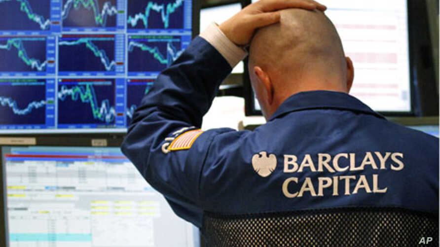 A trader watches his screen on the floor of the New York Stock Exchange.  U.S. stocks dropped for a second straight session as Libya's violence sent oil prices up briefly to $100 a barrel and tech shares sank, February 23, 2011.