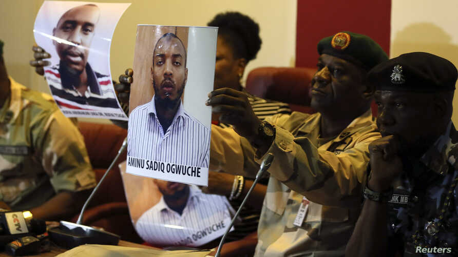 Photographs of Rufai Abubakar Tsiga (L) and Aminu Sadiq Ogwuchem are presented to the media by the State Security Service in Abuja, Nigeria, May 12, 2014.