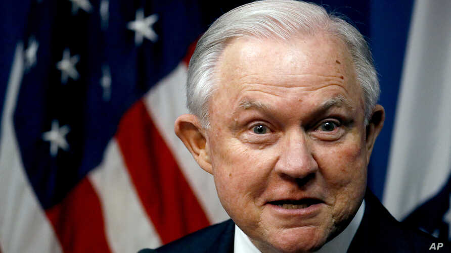 Attorney General Jeff Sessions talks about efforts to combat violent crime during a stop at the U.S. Attorney's Office, Sept. 13, 2018, in Kansas City, Missouri.