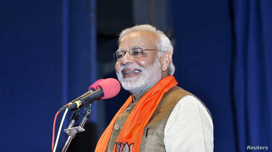 Hindu nationalist Narendra Modi, who will be the next prime minister of India, addresses Gujarat state lawmakers and party workers during the appointment of the state's new chief minister in Gandhinagar, May 21, 2014.