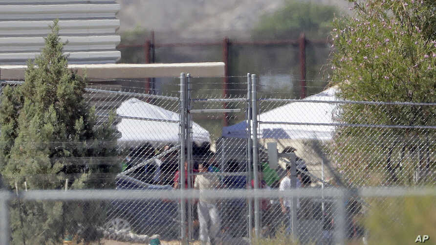 Detainees are seen at a facility where tent shelters are being used to house separated family members at the Port of Entry, June 21, 2018, in Fabens, Texas.