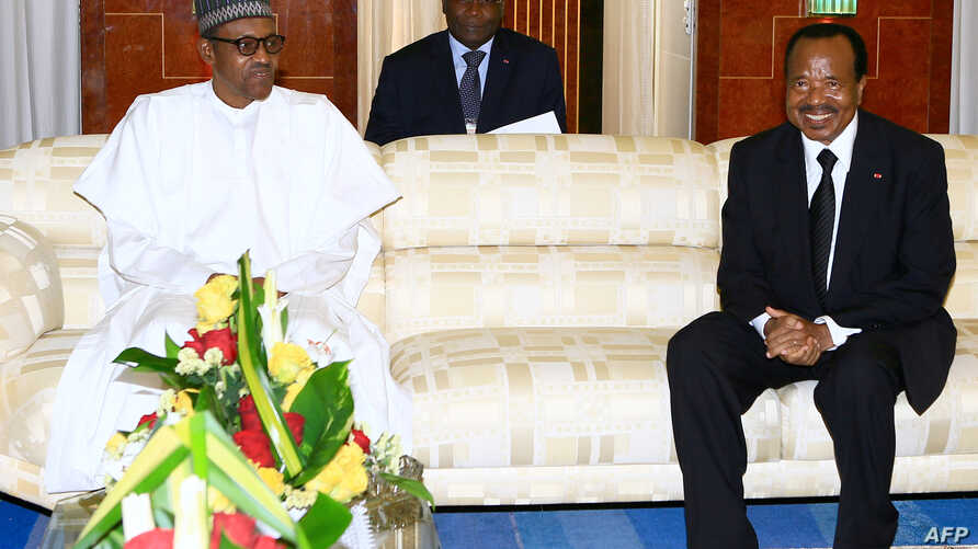 President of Cameroon Paul Biya (R) meeting with his Nigerian counterpart, Muhammadu Buhari, at the presidential palace in Yaounde, Cameroon, July 29, 2015.