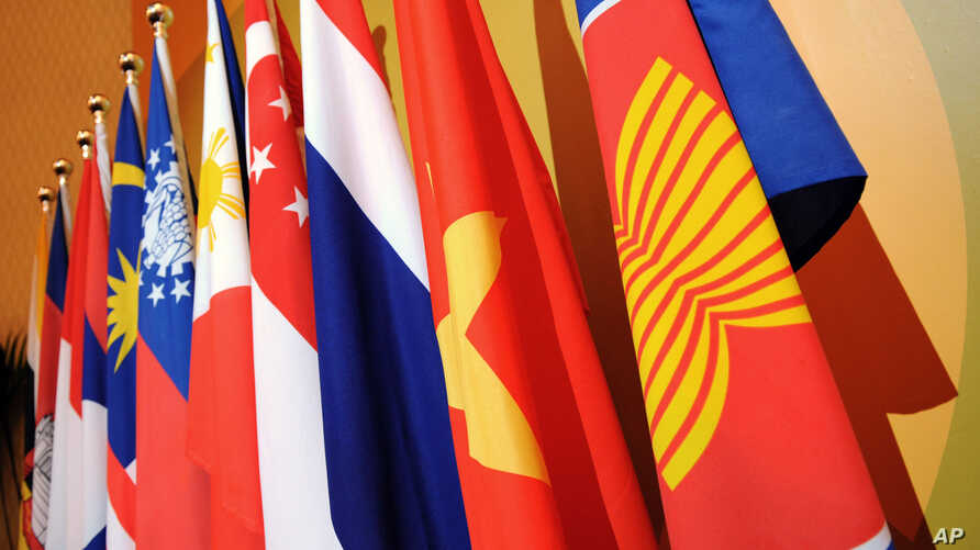 The Association of the Southeast Asian Nations (ASEAN) flag, right, leads the flags of the 10 member countries during the ASEAN Regional Forum meeting in Singapore.