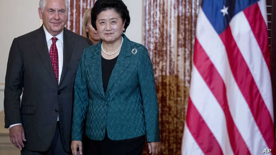 Secretary of State Rex Tillerson welcomes Chinese Vice Premier Liu Yandong during a working breakfast at the State Department, Sept. 28, 2017, in Washington.
