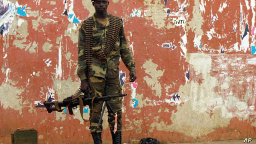 A soldier stands guard in a street near the National Assembly on April 13, 2012 in Bissau.