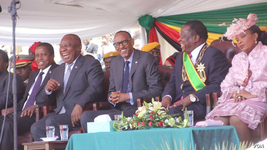 Presidents Edgar Lungu of Zambia, Cyril Ramaphosa of South Africa, and Rwanda's Paul Kagame – the African Union chairperson – shares a lighter moment with Zimbabwe's newly sworn in Emmerson Mnangagwa, Aug. 26, 2018, in Harare.