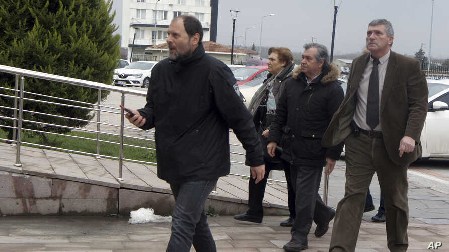 Parents of the arrested Greek soldiers, at center, arrive at the courthouse in Edirne, Turkey, March 5, 2018.