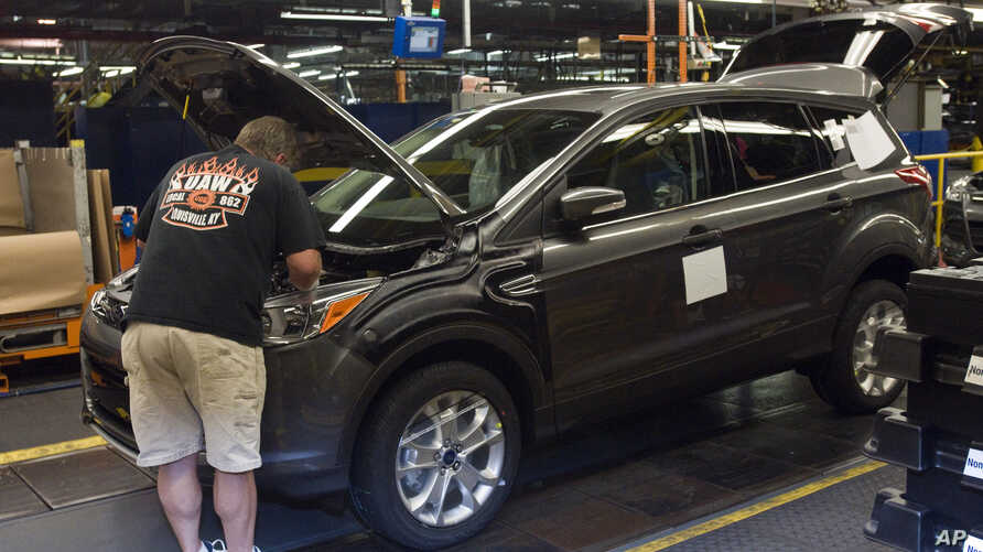 FILE - Louisville Assembly Plant workers build the redesigned 2013 Escape, June 13, 2012 in Louisville, Ky. Ford has transformed the nearly 60-year-old assembly plant into the new home of the redesigned Escape. And it's bolstered the workforce to ma