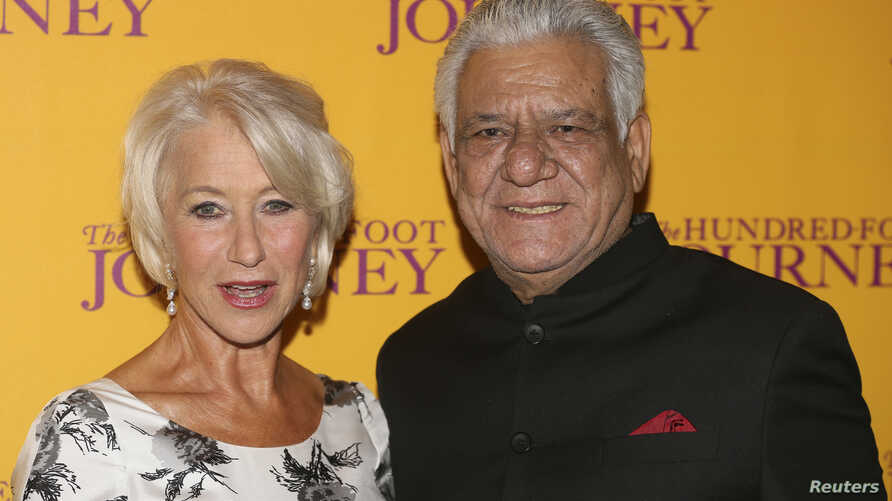 """Cast members Helen Mirren and Om Puri arrive for the British gala screening of """"The Hundred-Foot Journey"""" in London, Sept. 3, 2014."""