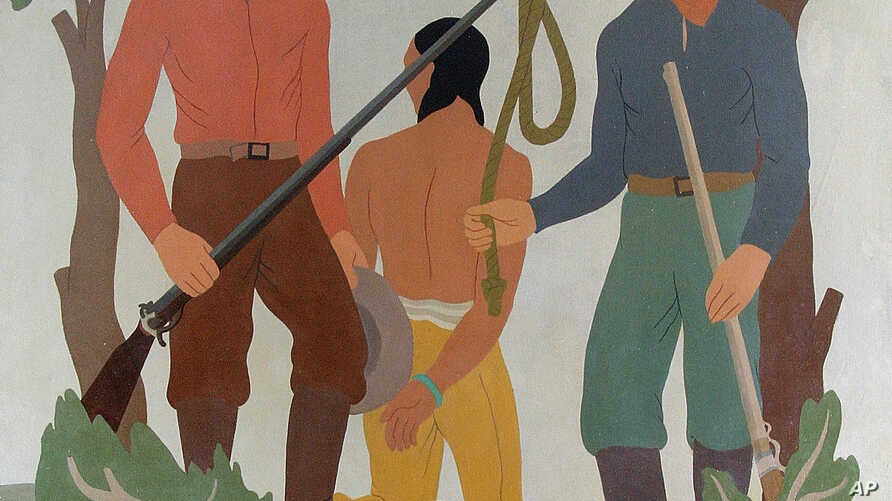 FILE - The University of Idaho in 2015 decided to cloak this controversial mural, created in the 1930s by WPA artist Ivan Bartlett, which depicts the lynching of a Native American. Once the Boise, Idaho, building served as the Ada County Courthouse.