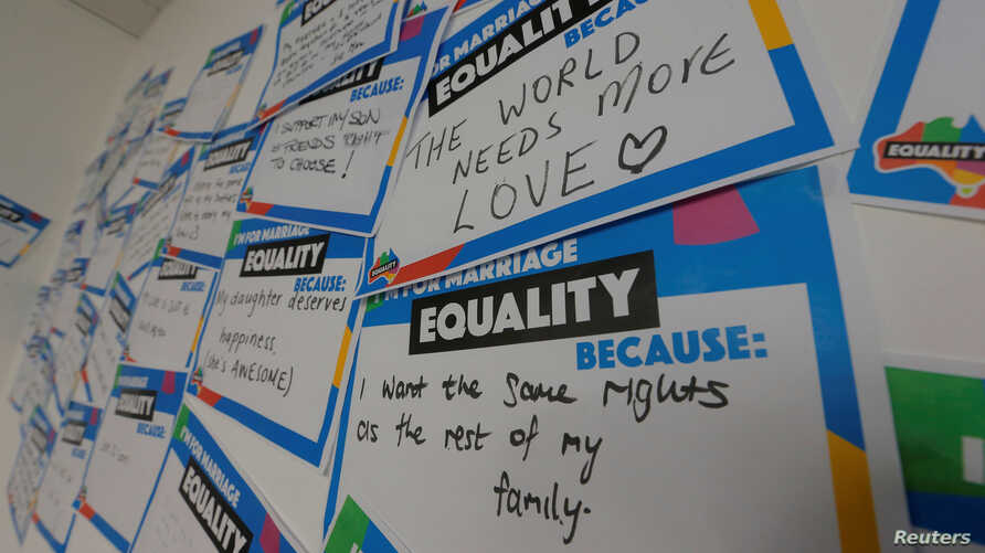 Hand-written messages line at a call center for the Yes campaign in Australia's gay marriage vote, as Australia's high court allows a government plan for a postal vote to legalize same-sex marriage, in Sydney, Australia, Sept. 6, 2017.