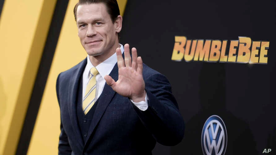 """John Cena attends the LA premiere of """"Bumblebee"""" at TCL Chinese Theatre, Dec. 9, 2018, in Los Angeles."""