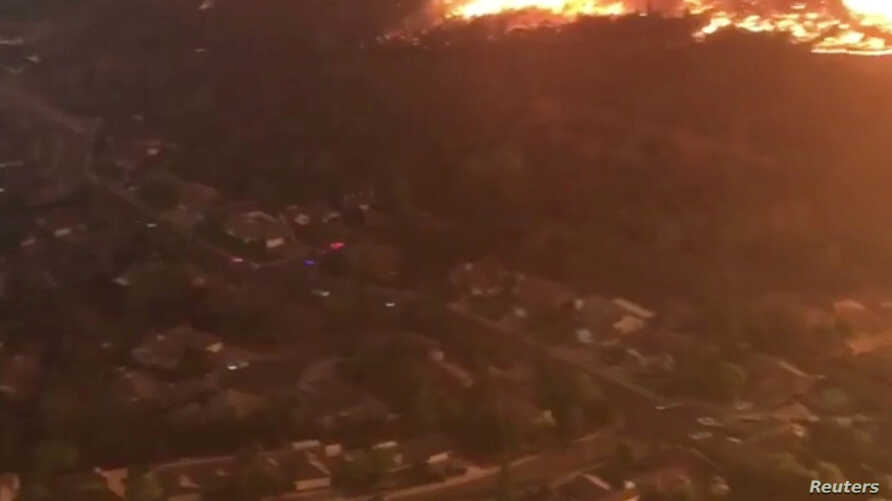 Aerial view of an area affected by wildfire in Redding, California, U.S. July 26, 2018, in this still image taken from a video obtained from social media.
