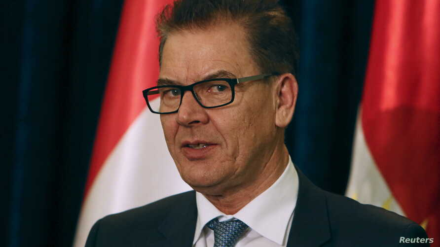 FILE - German Minister of Economic Cooperation and Development Gerd Mueller speaks during a news conference in Erbil, Iraq Jan. 27, 2016.