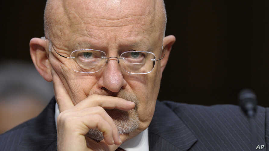 Director of National Intelligence James Clapper listens as he testifies on Capitol Hill in Washington, Tuesday, Mar. 12, 2013, before the Senate Intelligence Committee hearing on worldwide threats.