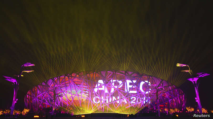 A screen displays the APEC logo on the National Stadium during a lights-and-fireworks rehearsal for the upcoming APEC Summit in Beijing, Nov. 4, 2014.