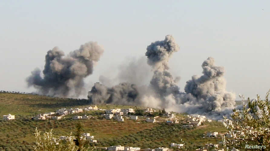FILE - Smoke rises after what activists said was an airstrike on Atimah, Idlib province, March 8, 2015.