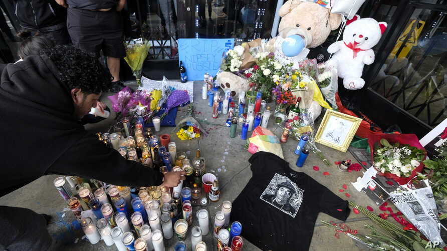 Fans of rapper Nipsey Hussle are seen gathered at a makeshift memorial in the parking lot of Hussle's Marathon Clothing store in Los Angeles, Califonia, April 1, 2019.