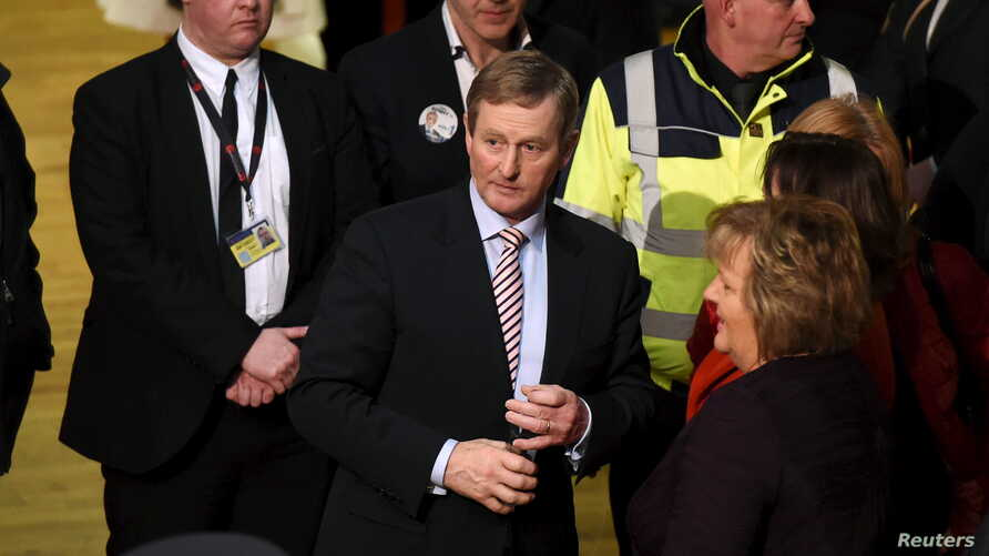 Irish Prime Minister Enda Kenny, center, leaves the general election count at the count center in Castlebar, Ireland, Feb. 27, 2016.
