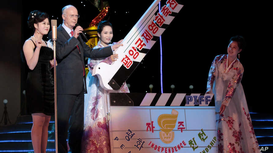 A clapperboard is held at the start of the opening ceremony of the 14th Pyongyang International Film Festival at the Ponghwa Art Theatre in Pyongyang, North Korea, Sept. 17, 2014.