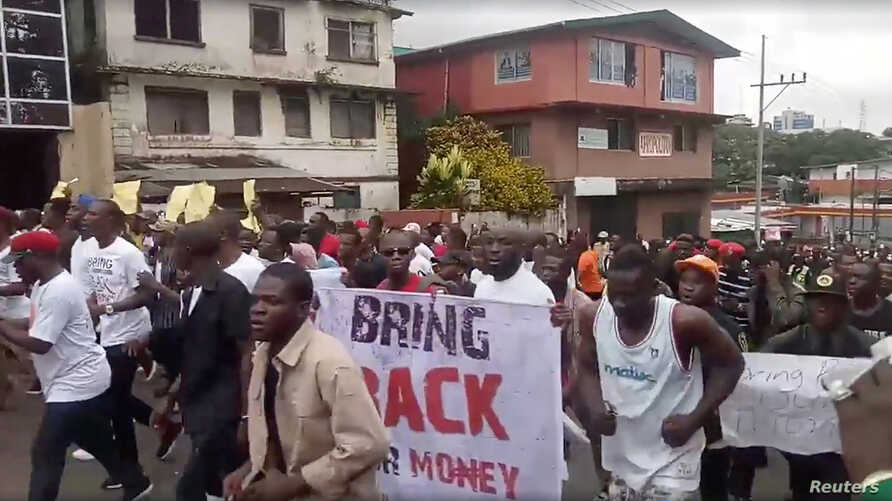 Civil society groups protest against the 104 million US dollars meant for the Central Bank that went missing from the port and the airport of Monrovia between 2017 and 2018, Monrovia, Liberia, Sept. 24, 2018 in this picture obtained from a social med