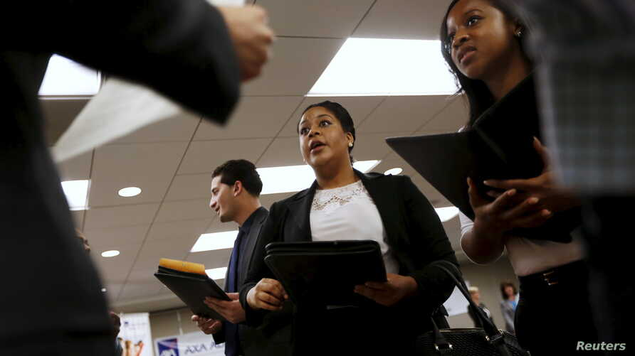 Job seekers listen to prospective employers during a job hiring event for marketing, sales and retail positions in San Francisco, California, June 4, 2015.